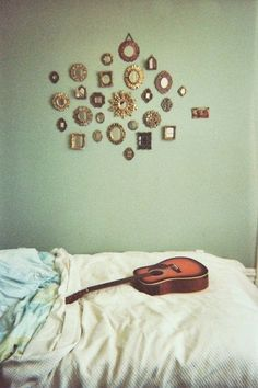 Display of adorable tiny mirrors is adorable. | 39 Easy DIY Ways To Create Art For Your Walls
