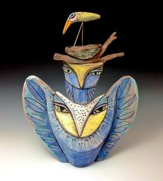 Featured Artist Blue Fire MacMahon presents her line of whimsical and spiritual #ceramic #sculptures on www.ArtsyShark.com