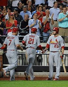 Craig gets congrats after he hit a 3 run homerun against the Mets.  Cards won 9-2.  6-11-13