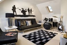 Would your Dad love a music room? Our Alders Edge development in Billingshurst has a black and white themed room, complete with stylish instruments including an electric guitar and drum kit.