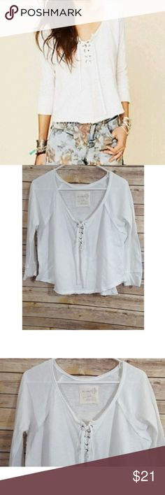 WE THE FREE White Lace Up Crop Tee Top This is a cute lace crop top in great used condition  My Measurements  Across the chest-21  Length-19  Sleeves-21 Free People Tops Crop Tops