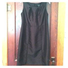 Very elegant black dress! Super elegant, classic black dress! You could dress it up with any color of jewelry. Looks very slimming and flawless on! George Dresses Midi