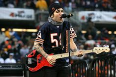 :o fall out boy's pete wentz in an urlacher jersey? perfection.
