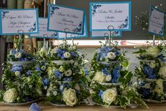 Beautiful display of wedding flowers for the table display at a summer ciuntry wedding.