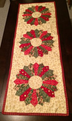 Get ready for the holidays with this Christmas Dresden Plate table runner. inches cotton fabric, machine washable Beautiful for your table or for a gift. Xmas Table Runners, Quilted Table Runners Christmas, Patchwork Table Runner, Christmas Runner, Quilted Table Runner Patterns, Christmas Patchwork, Dresden Plate Patterns, Table Topper Patterns, Dresden Quilt
