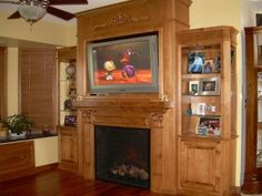 With Corinthian fluted columned mantle and scrolling wood appliqués, this complete wall unit has both beauty and function. Entertainment Center Wall Unit, Entertainment Center Makeover, Custom Fireplace, Tv Fireplace, Fireplaces, Wood Appliques, Bookshelf Desk, Electric Fireplace, Fireplace Surrounds