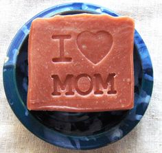 """I Heart Mom Soap - Aquarian Bath's """"I Heart Mom"""" Lavender Rose cold processed soap is a perfect mother's day gift or gift for a new mom. The soap was hand stamped and colored with Pink Kaolin (Rose) clay and is scented botanically with Lavender Essential oil, Rose Geranium essential oil, Bulgarian Rose wax and a small amount of Blood Cedarwood essential oil to fix the lighter florals."""