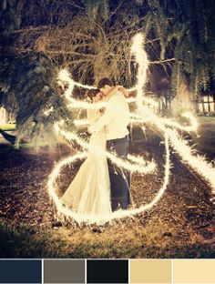 This is really neat, it reminds me of  seeing fairytale magic happening. It's a long exposure shot with sparklers. All they had to do was stand there very still and someone else ran around them with a sparkler.