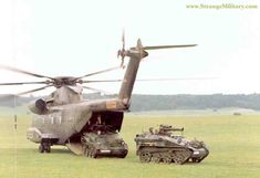BABY TANKS ARRIVE BY HELICOPTER