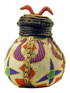 Africa | Beaded gourd from the Yoruba people of Nigeria | Beads were signs of wealth and status. Many Yoruba sacred and secular objects were embellished with elaborate images and symbolic designs created by small glass beads. | © Tim Hamill