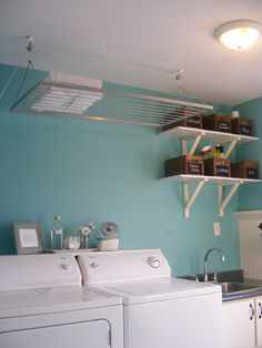 Great storage idea.. shelf with pulley that allows storage at ceiling height! Love it!