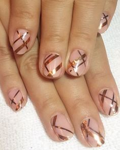 Try this copper look by adding strips of metallic nail tape in a slapdash plaid design on top of a nude nail. Finish the look with a clear top coat. Design by @naominailsnyc
