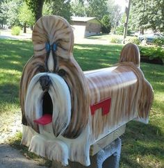 You've Got Mail! 18 Crazy Cool Novelty Mailboxes...thought of gus..would need to have a pink mohawk instead of blue bow