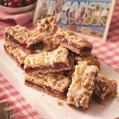 Cranberry Date Bars Recipe  1 pkg (12 oz) fresh or frozen cranberries  1 pkg (8 oz) chopped dates  1 tsp vanilla extract  2 C all-purpose flour  2 cups quick-cook oats  1-1/2 cups packed brown sugar  1/2 tsp baking soda  1/4 tsp salt  1 cup butter, melted  ORANGE GLAZE:  2 cups confectioners' sugar  2 to 3 Tb orange juice  1/2 tsp vanilla extract