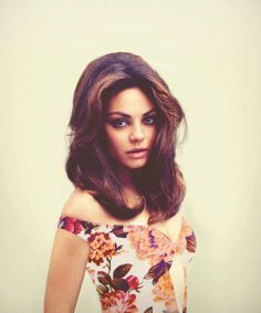 Mila Kunis looking like she's straight out of Italy in the 60's