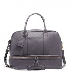 Roomy grey travel bag with a zippered shoe compartment and removable crossbody strap. Great for weekend trips.