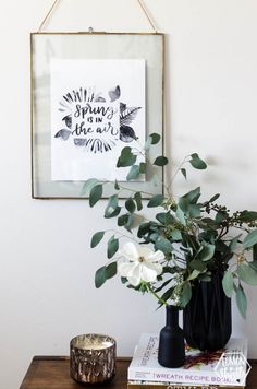 I love this hand lettered watercolour pieces! it\'s perfect for spring with those leaves and I love how modern the black watercolor looks. Free Printable Spring Decor, \'spring is in the air\'
