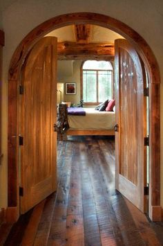 arched double doors and reclaimed floors - beautiful!!