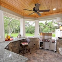 Beautiful Outdoor Kitchen Design With Concrete Stone And Marble Countertop Decorated By White Pillars And Ceiling Fan Stunning Outdoor Kitchen Design - Unprecedented Comfort in summer Kitchen design