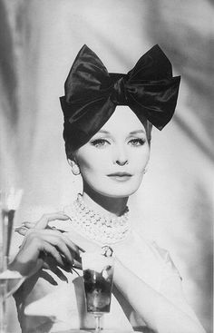 50s model Anne St Marie with an amazing head piece