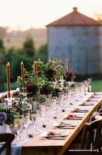 Wedding by Beehive Events - love the lush, purple arrangements and the tall candles with wax dripping