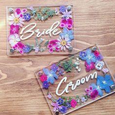 プレ花嫁の結婚式(ウェディング)準備サイト marryマリーさんはInstagramを利用しています:「* お花いっぱいの手作り#受付サイン が可愛い💐💭💫 * 2枚のアクリルボードに#押し花 を挟んで、 白い油性ペンで文字をかいてdiyしたそうです💎 * #アクリルボード と押し花を使ったデザインは いま絶賛流行中💓✨💓 ナチュラル感はもちろん、…」