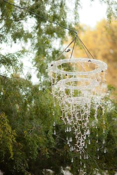 DIY outside chandelier-like the idea of attaching crystals to the ends of the icicle lights
