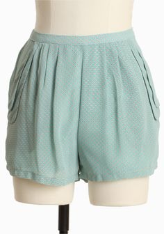 """Fresh Mint Polka Dot Shorts 32.99 at shopruche.com. Delicate chiffon is crafted into a charming pair of mint hued shorts. Finished with a playful coral and white polka dot print, side pockets, and a hidden side zipper closure. Fully lined.100% Polyester, Imported, 12.5"""" length, 29"""" waist, Measurements taken from size small"""