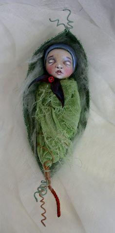 Sleeping Elfbaby in leaf cradle.