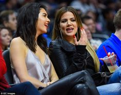 Stylish star: Khloe also kept warm in a leather jacket which she styled with baggy boyfriend jeans