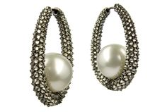 White Pearl Earrings by Baggins Two South Sea pearls are the stars of these elegant earrings from the California-based jeweller. The gems balance on a circle of 18-carat white gold and black rhodium, encrusted with shimmering light cognac diamonds.