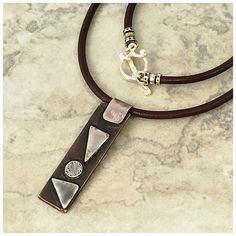 A personal favorite from my Etsy shop https://www.etsy.com/listing/292409779/leather-choker-with-copper-and-sterling