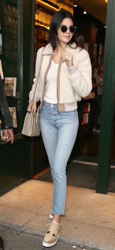 Kendall Jenner will walk in this year's Victoria's Secret fashion show! Now, let's celebrate by checking out some of her stellar outfits, including these high-waisted jeans, shearling jacket, and beige mini Celine bag