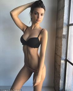 Abs-olutely fabulous: The Blurred Lines beauty looked phenomenal in a black push up bra and skimpy nude bottoms, which clung to her pert derrière