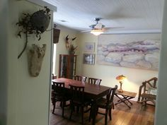 120 year old farmhouse dining room remodel. Note the original wood ceiling.