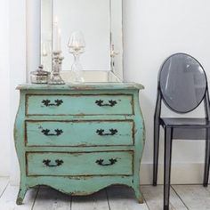 Steps for Painting Furniture in Shabby Chic Style  - Unloved piece of furniture  - Paint stripper (if it's an old piece with a finish on it)  - Sandpaper  - Paintbrush  - Cream color paint in satin/semi gloss (for top coat)  - Natural color paint (for base coat)  - Clean cloth  - Wax stain and/or varnish