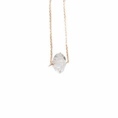 """HERKIMER DIAMOND CRYSTAL NECKLACE by JULIA SZENDREI """"I am filled with clairvoyant energy."""" Fluid thoughts flow inward and outward to create a better concentration towards your goals. Natural Herkimer Crystals terminate at each end with clarity that resembles a Diamond. 17.5"""" set length 14k gold filled chains. Shop Now www.juliaszendrei.com"""