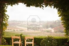 Vine Covered Patio and Chairs with Beautiful Country View. Stock Photo