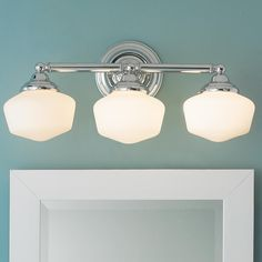 """Schoolhouse 3-Light Bath Light The Chrome finish and satin white schoolhouse glass will add instant classic vintage charm to your bathroom. (23 1/4''W x 10''H x 10"""" Extension). 3 x 60W"""
