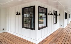 Farmhouse Front Porch Design Installed on this house's front porch, multiple wall sconces help establish an elevated farmhouse decor! Farmhouse Front Porches, Modern Farmhouse Exterior, Rustic Farmhouse, Farmhouse Windows, French Farmhouse, Cottage Farmhouse, Farmhouse Interior, D House, House With Porch