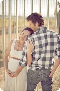 Brilliant pose. Belly, affection, wedding ring, all in one shot without being typical. #maternity