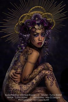 Photo: Ian Carre-Burritt Model & HMUA: Yuma Bastet Bodypaint: Michael Rosner Headdress: Miss G Designs  #headdress #headpiece #crown #purpleflowers #bodypaint #bodyart #flowerheadband #missgdesigns