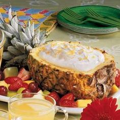 What a fun appetizer. Pineapple fruit boat with fluffy fruit dip :)
