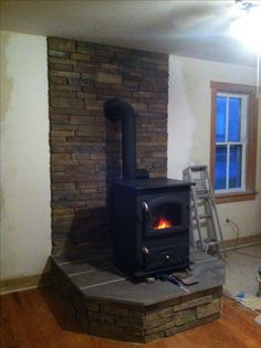 Raised Flagstone Hearth With Wood Stove