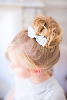 Pin for Later: The Sweetest Holiday Hairstyles For Little Girls Curled Sock Bun With a Bow