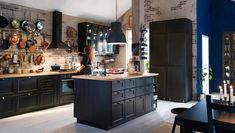 black kitchen cabinets exposed brick wall whitewashed #dark #kitchen