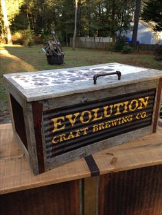 Jockey box cover #3 for Evolution Craft Brewing. Pallet wood, rusted corrugated roofing, door panels from old stove with bullet holes for the counter surface. Folds up.