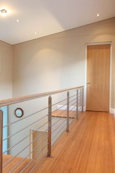 BAMBOO HANDRAIL ON STAINLESS STEEL UPRIGHTS. SPECIAL STAINLESS STEEL DETAIL IN THE HANDRAIL