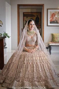 Pretty pale pink shimmer Lehenga with foil and gota work perfect for a day wedding or intimate wedding. (C) Falguni Shane Peacock India #wittyvows #intimatewedding #homewedding #bridalhair #bridalmakeup #bridaljewellery #bridallehenga #pinklehenga #brideandgroom #indianweddinginspiration #weddingideas Latest Bridal Lehenga, Designer Bridal Lehenga, Indian Bridal Lehenga, Indian Bridal Outfits, Indian Dresses, Bridal Dresses, Ceremony Dresses, Indian Bridal Wear, Pakistani Bridal
