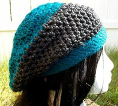 Teal and charcoal. Great for any season this striped slouch hat is Teal and a charcoal grey. Available to order @ facebook.com/hooka.yarn